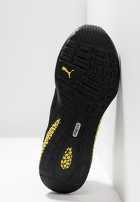 Puma - HYBRID NX CAUTION - Neutral running shoes - black/blazing yellow - 4