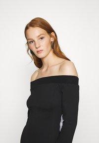 Calvin Klein Jeans - OFF THE SHOULDER MILANO DRESS - Shift dress - black - 5