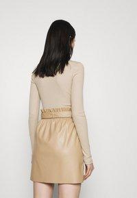 Vero Moda - VMMIA HIGHNECK BODY - Long sleeved top - beige - 2