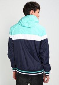 Urban Classics - HOODED COLLEGE WINDBREAKER - Summer jacket - navy/mint/white - 2