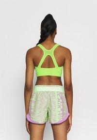 Nike Performance - BRA  - Medium support sports bra - lime glow/barely green - 2