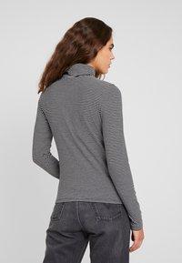 Levi's® - TURTLENECK - Long sleeved top - black/white - 2