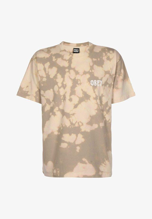T-shirt con stampa - humus