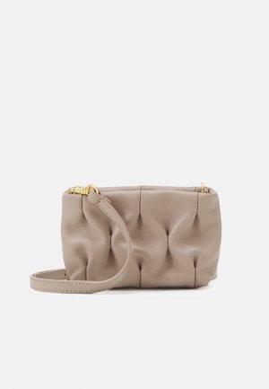 OPHELIE GOODIE CROSSBODY - Across body bag - powder pink