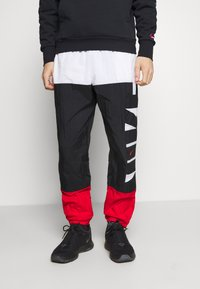 Nike Performance - STARTING PANT - Tracksuit bottoms - white/black/university red - 0