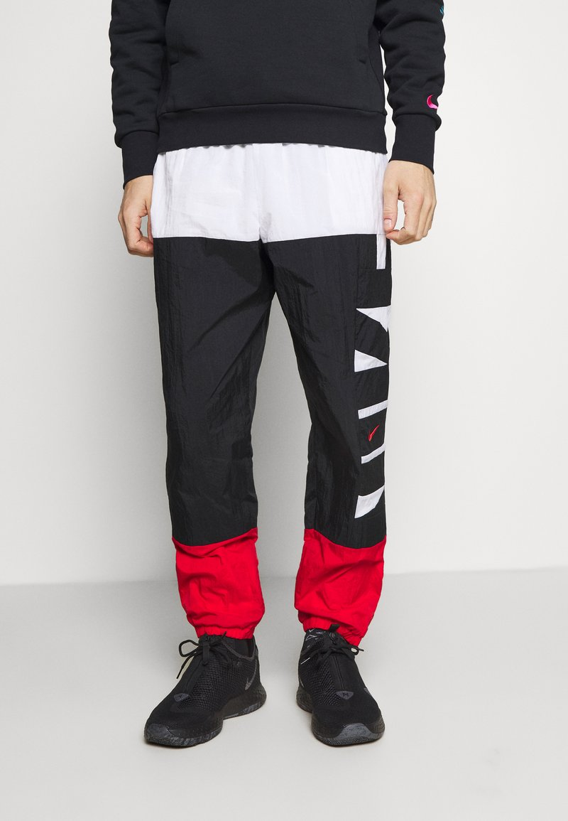 Nike Performance - STARTING PANT - Tracksuit bottoms - white/black/university red