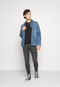 Levi's® - SKINNY TAPER - Vaqueros pitillo - black denim - 1