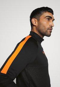 Nike Performance - AS ROM - Club wear - black/safety orange - 4