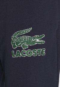 Lacoste - Tracksuit bottoms - navy blue - 9
