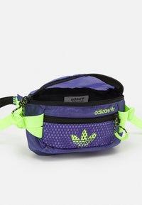 adidas Originals - WAISTBAG UNISEX - Bum bag - purple/black/signal green - 2