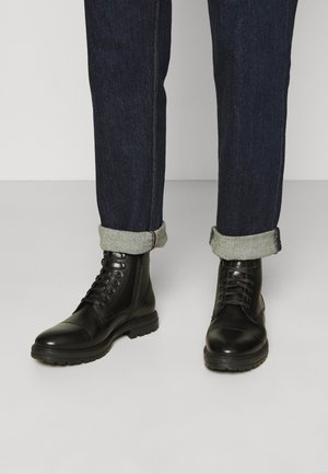 JOHNNY - Lace-up ankle boots - black