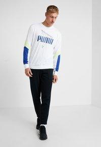 Puma - TILITY PANT - Träningsbyxor - puma black - 1