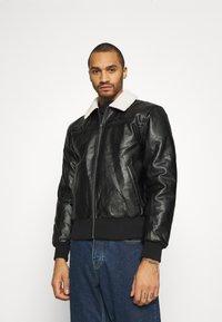 Karl Kani - RETRO JACKET - Faux leather jacket - black - 0
