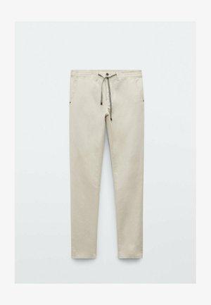 IM VINTAGELOOK  - Trousers - beige