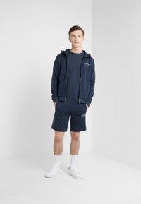 BOSS - HEADLO WIN - Pantalon de survêtement - blue/silver - 1