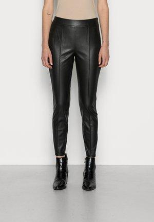 RECYCLED - Leggings - Trousers - black