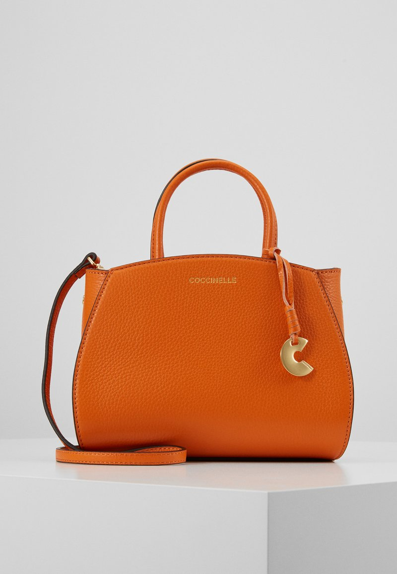 Coccinelle - CONCRETE HANDBAG - Handbag - ginger