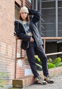 The North Face - TECH PANT - Pantalon de survêtement - black - 1