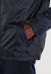 JAKO - TEAM - Waterproof jacket - marine - 5