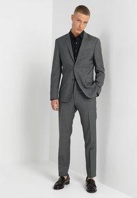 Calvin Klein Tailored - EXTRA SLIM - Formal shirt - black - 1