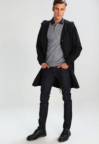 Diesel - THOMMER-X - Slim fit jeans - blue-black - 1