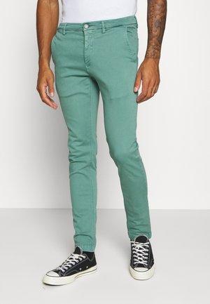 ZEUMAR HYPERFLEX  - Trousers - jade green