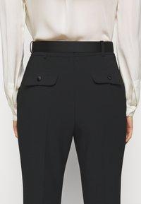Elisabetta Franchi - PANTS WITH BELT - Kalhoty - black - 6
