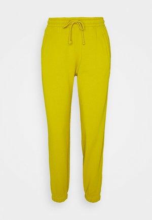 ONCE - Teplákové kalhoty - gelb