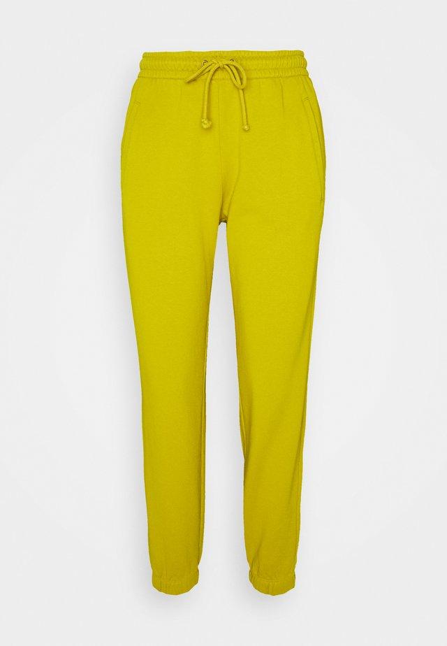 ONCE - Spodnie treningowe - gelb