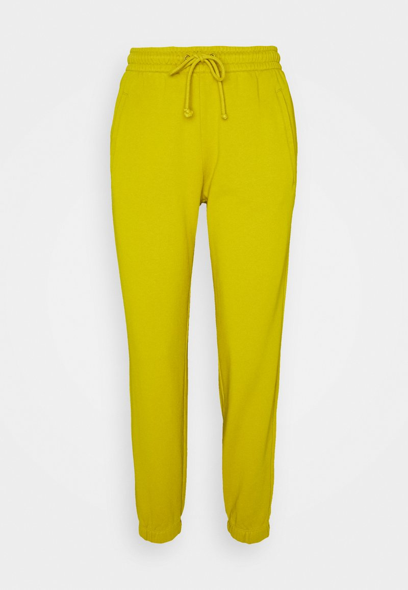DRYKORN - ONCE - Tracksuit bottoms - gelb