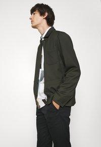 Filippa K - LOUIS GARBADINE - Summer jacket - moss green - 3