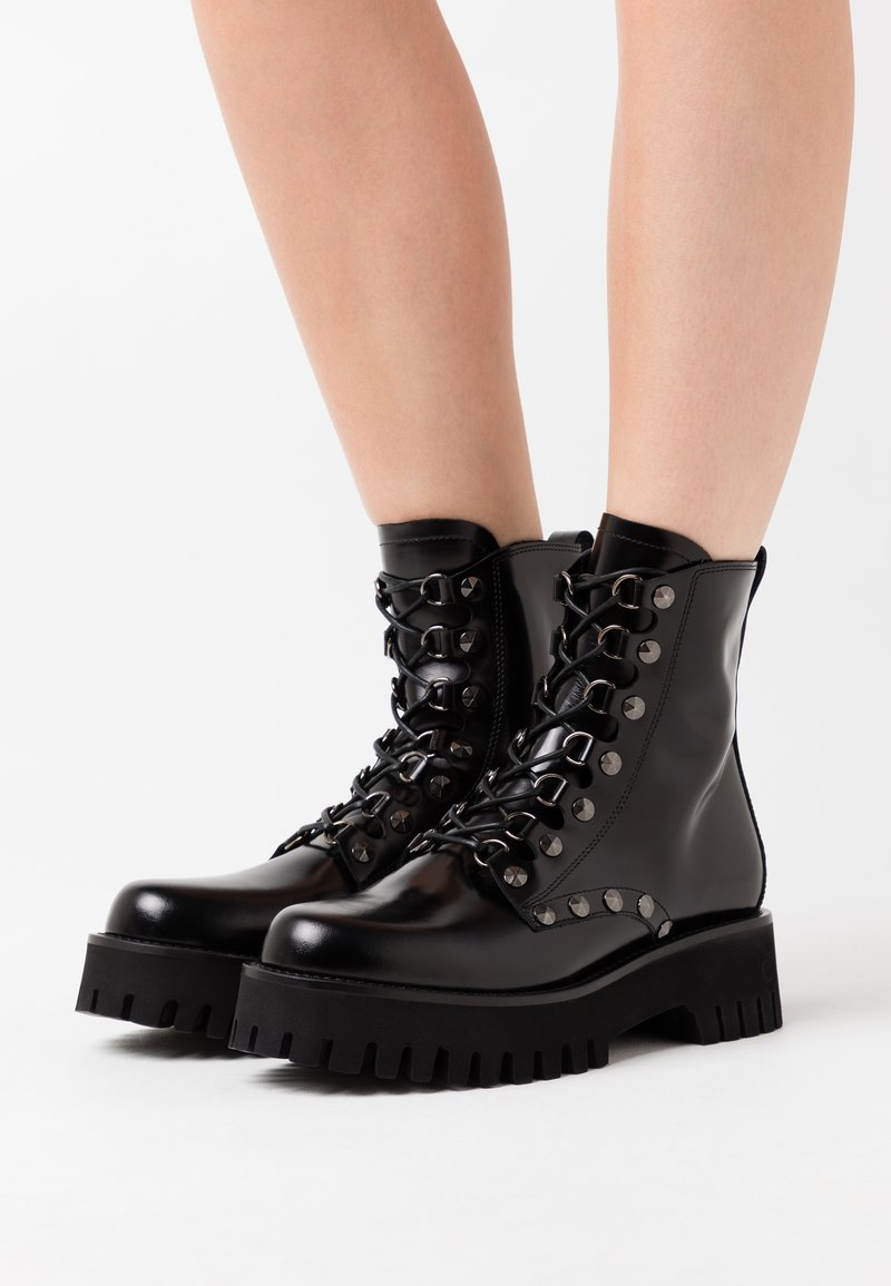 Casadei - Cowboy/biker ankle boot - brushed nero