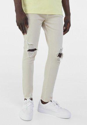MIT RISSEN  - Jeans Skinny Fit - nude