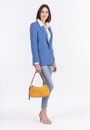 Käsilaukku - yellow