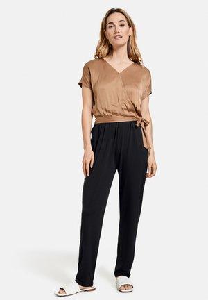 Trousers - schwarz/ecru/weiss patch