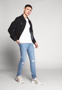 Levi's® - SKINNY TAPER - Jeans Skinny Fit - light blue denim - 1