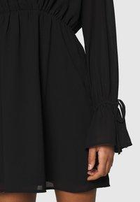 NA-KD - STRAP TIE MINI DRESS - Day dress - black - 4