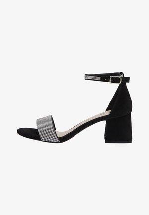 NIKA - Sandals - black