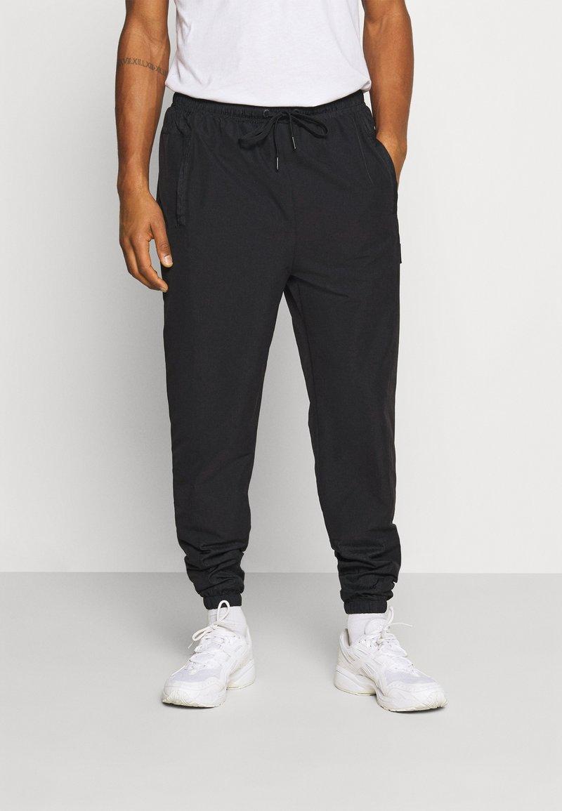Ellesse - STOREO - Pantalones deportivos - black
