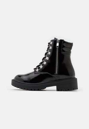 GOLDIE - Lace-up ankle boots - black