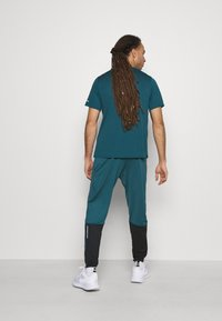 Nike Performance - ESSENTIAL PANT - Tracksuit bottoms - dark teal green/black/ghost green - 2