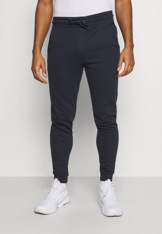 CUFF JOGGER - Pantaloni sportivi - blue