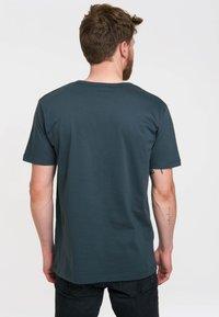 LOGOSHIRT - Print T-shirt - blau-schwarz - 4
