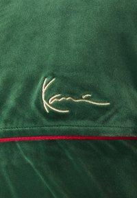Karl Kani - SMALL SIGNATURE TRACK JACKET UNISEX - Training jacket - darkgreen - 2