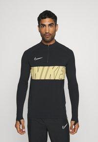 Nike Performance - DRY ACADEMY - Tekninen urheilupaita - black/jersey gold/white - 0