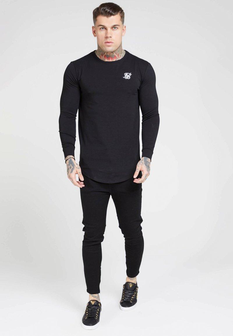 SIKSILK - GYM TEE - Long sleeved top - jet black