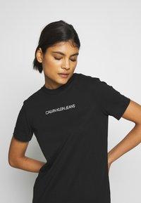 Calvin Klein Jeans - INSTITUTIONAL DRESS - Žerzejové šaty - black - 3