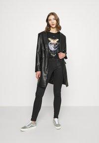 G-Star - LYNN MID SKINNY WMN - Jeans Skinny Fit - black radiant cobler - 1