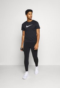 Nike Performance - ELITE PANT - Pantalon de survêtement - black/black - 1