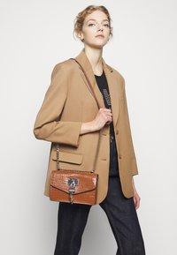DKNY - ELISSA SHOULDER - Across body bag - caramel - 1